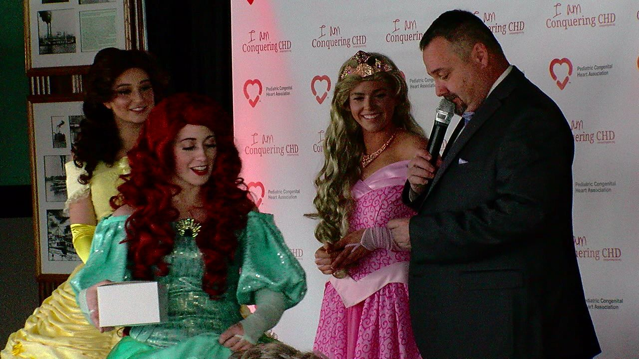A surprise from princesses brought a big smile to one of the children taking part in the Heart Hero Fashion Show. (WKRC)