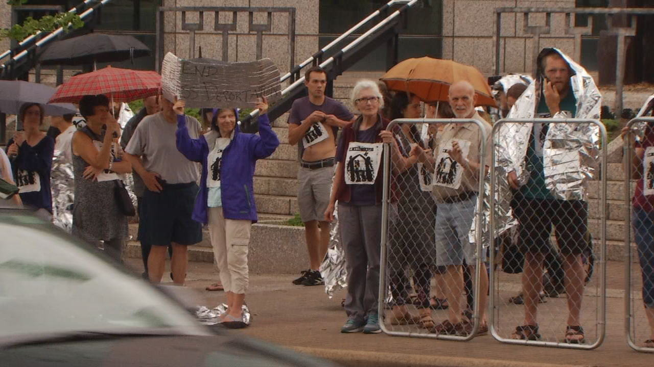 Protests broke out in Asheville a day after President Donald Trump signed an executive order directing the Department of Homeland Security to begin detaining families together instead of separating parents and children. (Photo credit: WLOS staff)