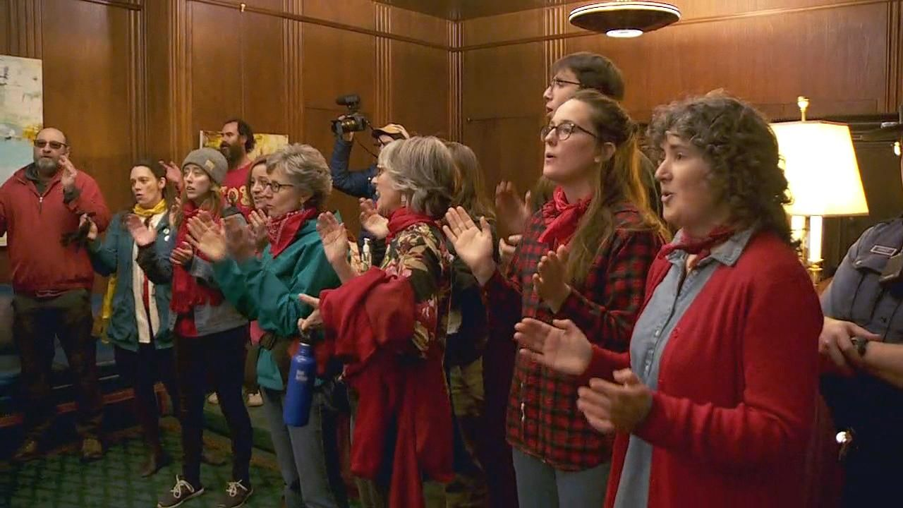 Opponents of a liquefied natural gas pipeline through Oregon protest in Gov. Kate Brown's office at the Capitol in Salem, Oregon Thursday, Nov. 21, 2019. (KATU Photo)