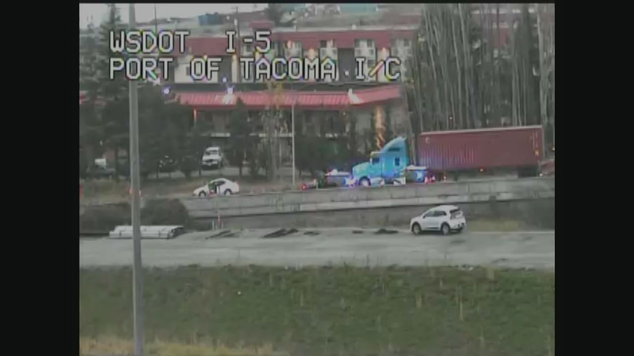 Driver riddles semi with bullets after crash on I-5 in Tacoma (WSDOT Photo)