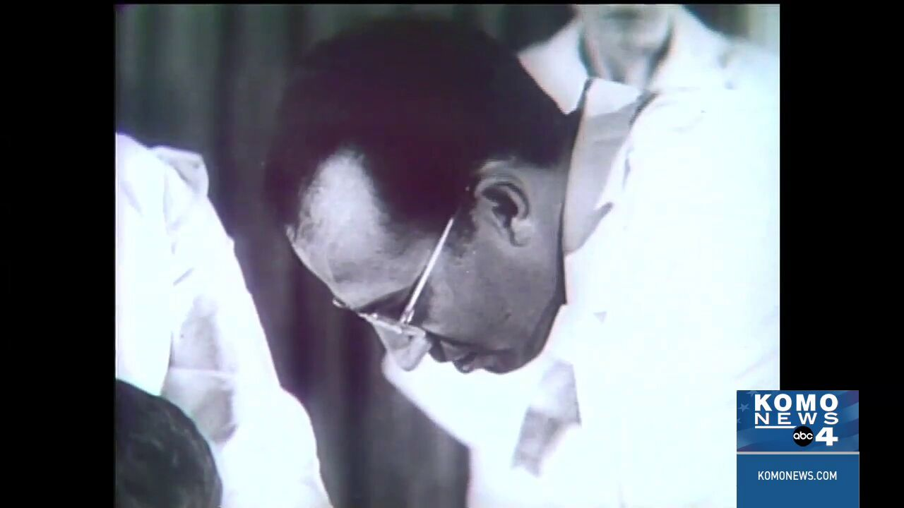 Dr. Jonas Salk shown while administering the polio vaccine.