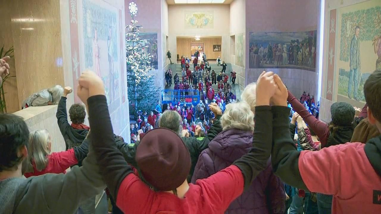 Opponents of a liquefied natural gas pipeline through Oregon fill the rotunda inside the Capitol in Salem, Oregon Thursday, Nov. 21, 2019. (KATU Photo)
