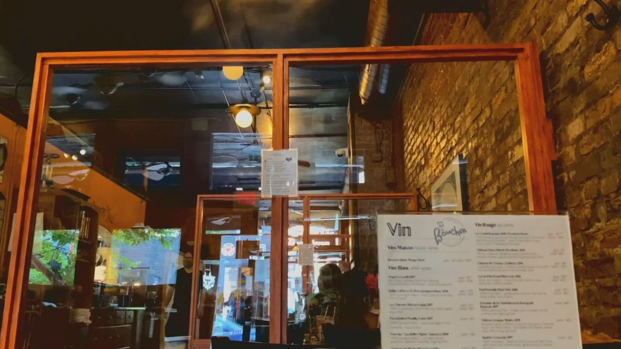 Plexiglass dividers set up in Bouchon, a french comfort food style restaurant located in downtown Asheville, North Carolina, give customers an extra layer of separation and safety. (Photo credit: WLOS Staff)