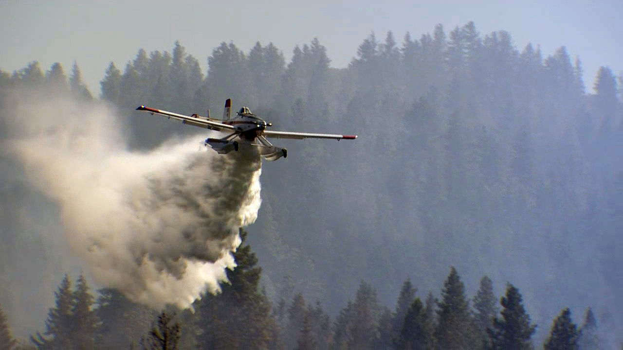 An airplane drops water on the Mosier Creek Fire in the Columbia River Gorge on Thursday, Aug. 13, 2020. (KATU)