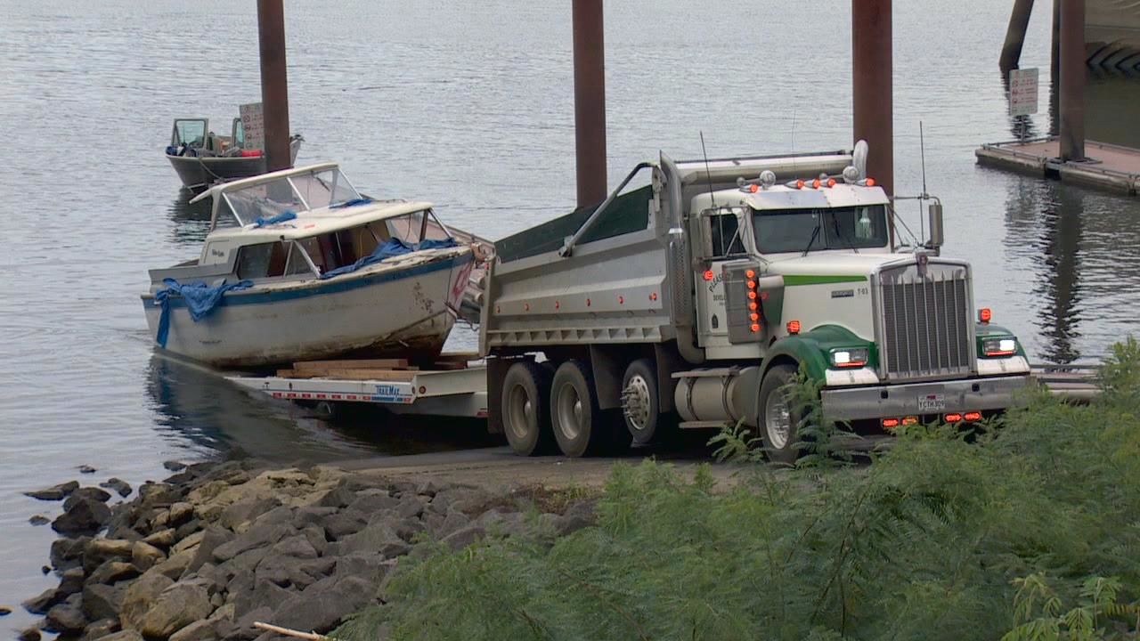 The Oregon State Marine Board hired a crew to remove abandoned boats along the shoreline of the Columbia River in North Portland on Friday, Sept. 20, 2019. (KATU Photo)