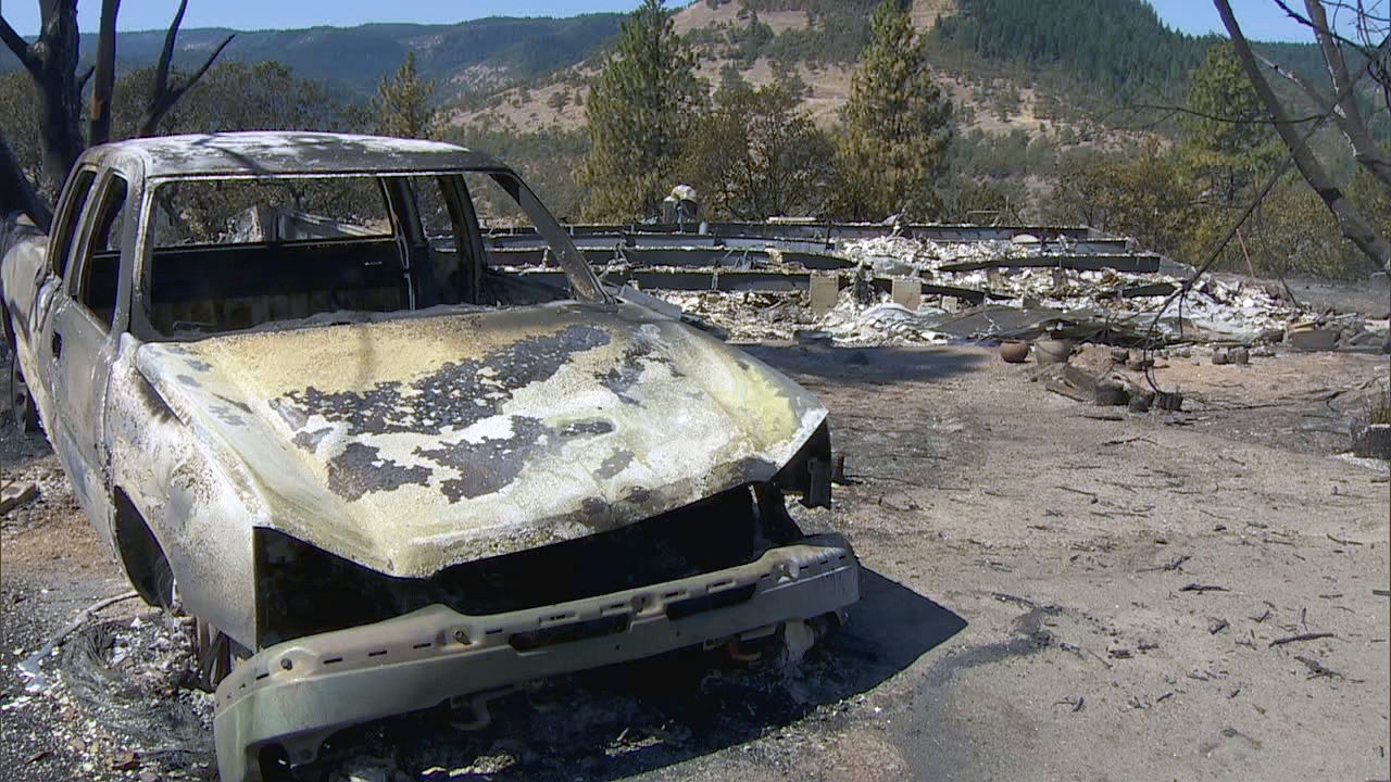 A burned out shell of a car sits among the devastation Thursday, Aug. 13, 2020 after the Mosier Creek Fire in the Columbia River Gorge burned through the area. The fire had burned 800 acres and forced 900 people to evacuate. (KATU)