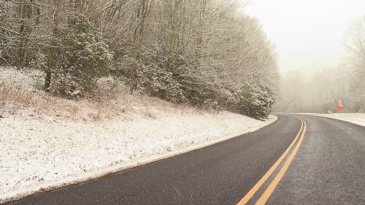 Snow falling in the Soco Gap area of Haywood County on Thursday, Feb. 20, 2020. (Photo credit: WLOS Staff)
