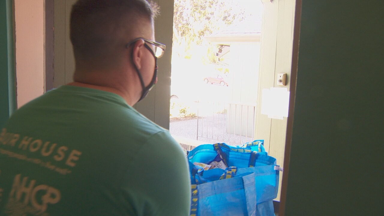 Food from Esther's Pantry is wheeled out to Luke Marshall's car for delivery to Cascade Aids Project clients. (KATU)
