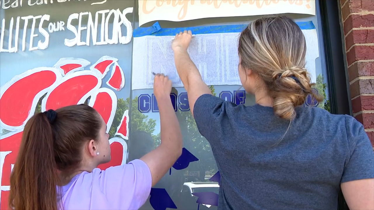 Henderson County seniors showed their class pride on the Chick-fil-A windows. (Photo credit: WLOS staff)