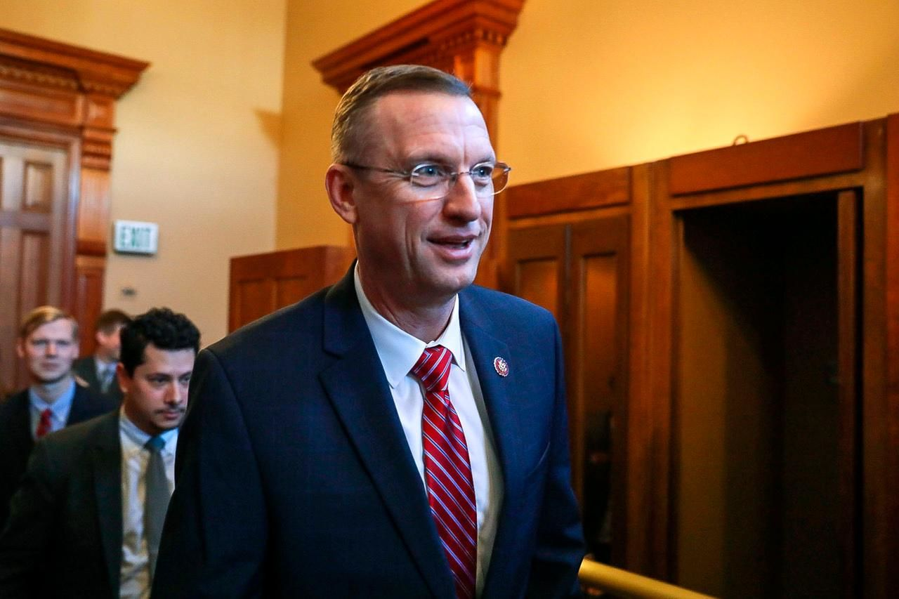 Georgia Rep. Doug Collins walks with colleagues at the state capitol in Atlanta, Tuesday, Jan. 28, 2020. Collins, an ardent ally of President Donald Trump and vocal opponent of his impeachment, is expected to announce he will challenge fellow Republican and newly appointed Sen. Kelly Loeffler for her seat this year, a Republican official said. (Riley Bunch/The Daily Times via AP)