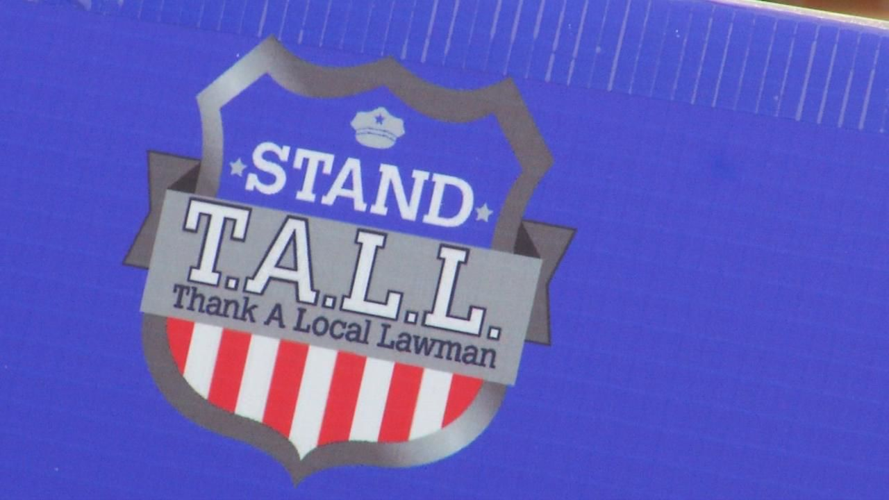 <p>Stand TALL (Thank A Local Lawman) hosted an evening of food and live music Friday night. (Photo credit: WLOS staff)</p>