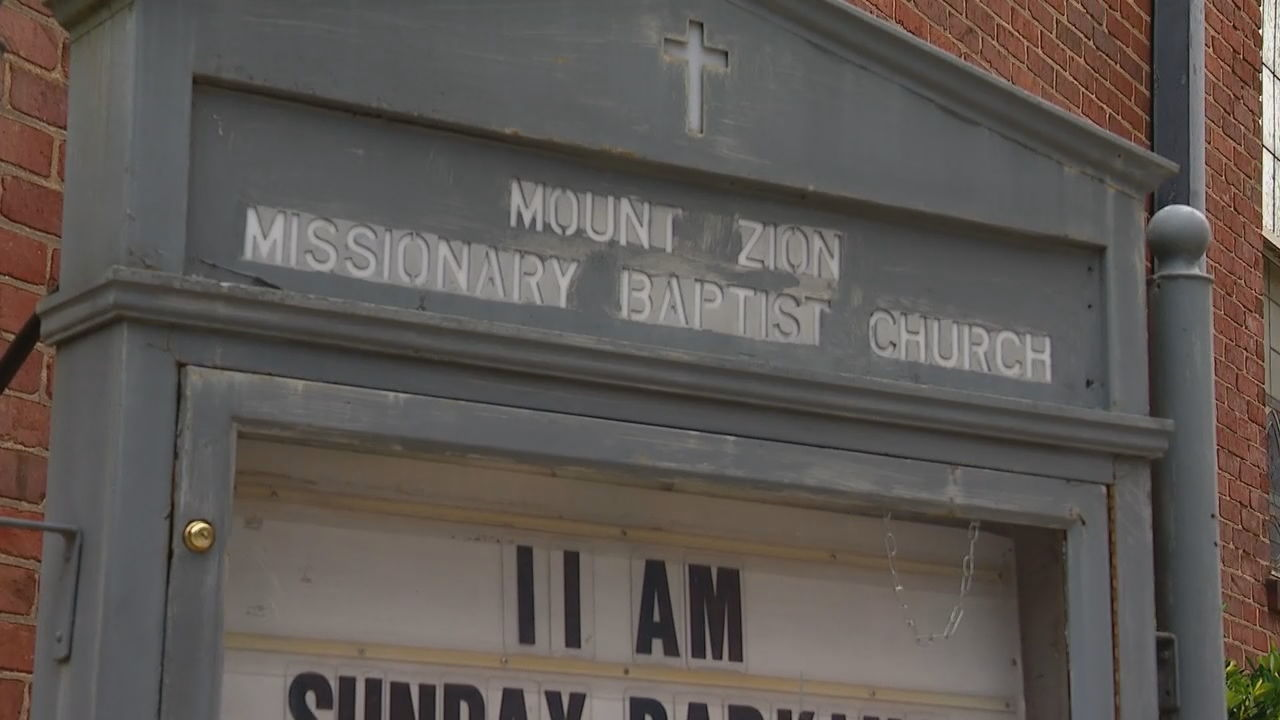 Pastor John Grant, who has led Mt. Zion Missionary Baptist Church in Asheville for decades, wants the Asheville City Council and other city leaders to do more than express their outrage over a handcuffed black man was killed by a white police officer in Minneapolis. (Photo credit: WLOS staff)