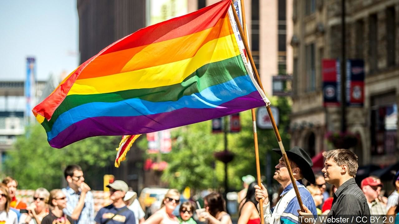 Waving Rainbow Flag at Twin Cities Pride Parade, Minneapolis (MGN).