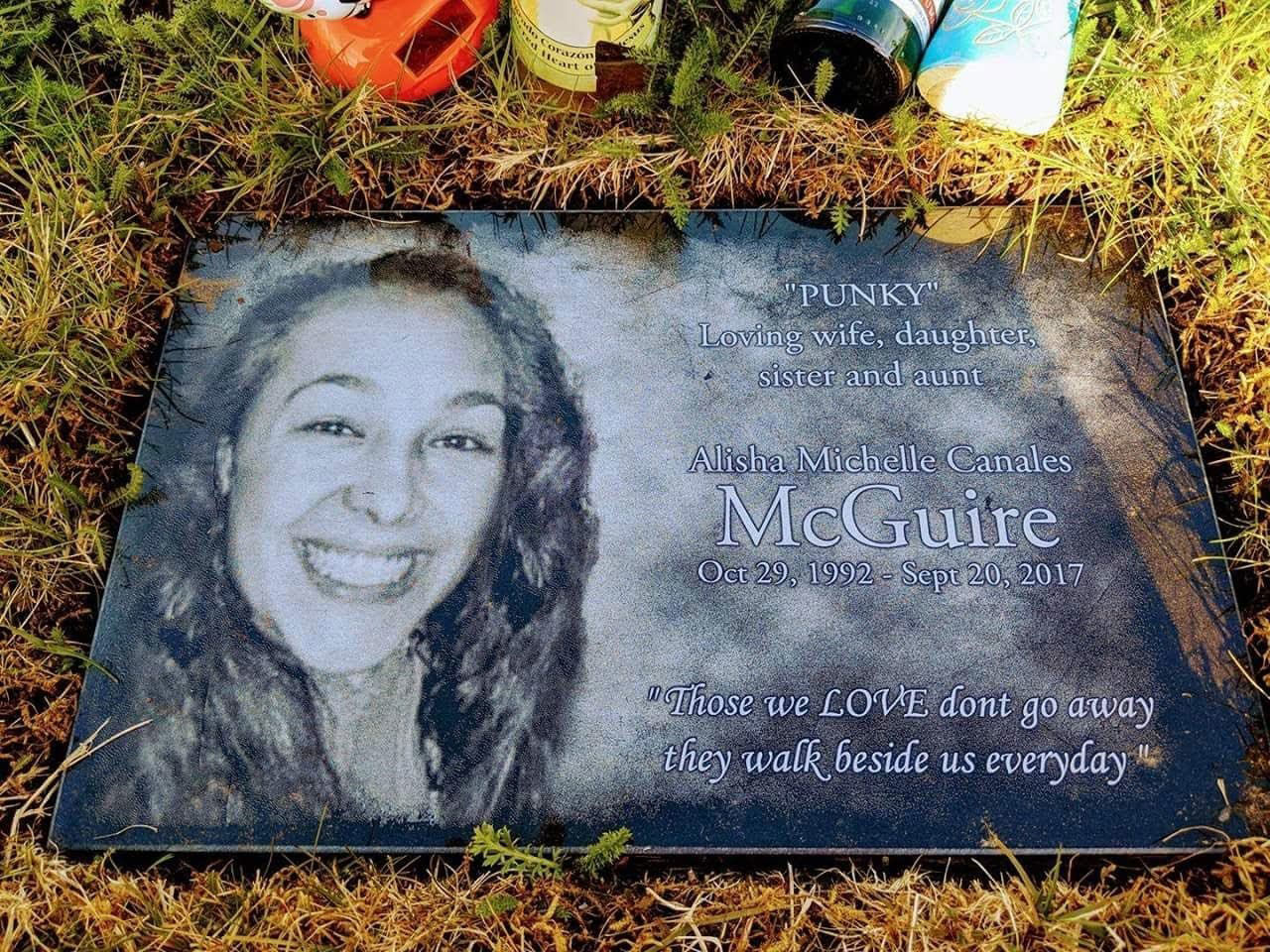 Alisha Canales-McGuiree's headstone is seen in a family photo.{ }(Photo courtesy of Amanda Canales)