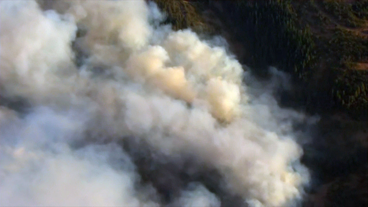 A wildfire burns in the Columbia River Gorge near Mosier, Oregon on Wednesday evening, Aug. 12, 2020. (KATU/Chopper 2)