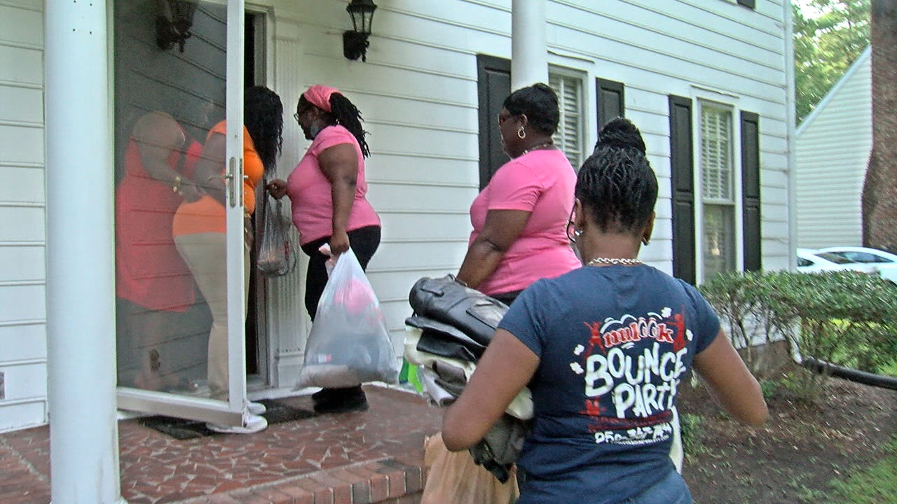 Shelia Leggete and her friends with the Nulook Steppaz donated items to the Brown family to help their rebuilding efforts. (Tyler Hardin, NewsChannel 12's photo)