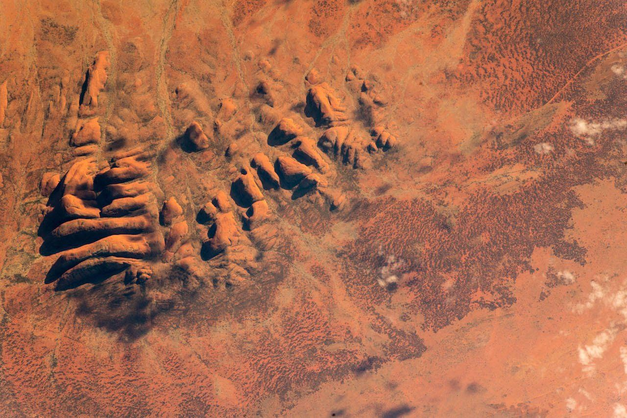 Kata Tjuta (also known as The Olgas) is a remarkable rock formation in the Australian Outback. Unbelievable, but there is a green oasis right in the middle between the 1 km high rock faces. Thanks to @astro_ricky for the photo.  (Photo & Caption Alexander Gerst, NASA)