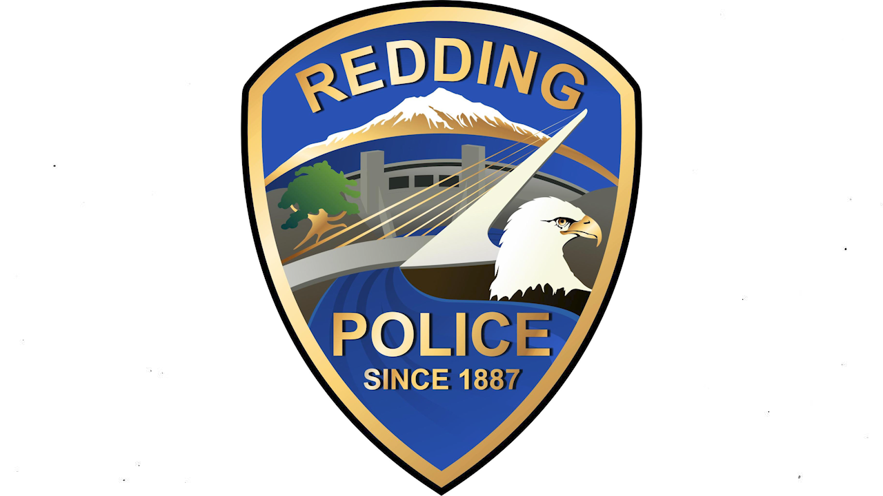 Redding Police Department Badge on White Background. (Badge photo courtesy of the Redding Police Department)