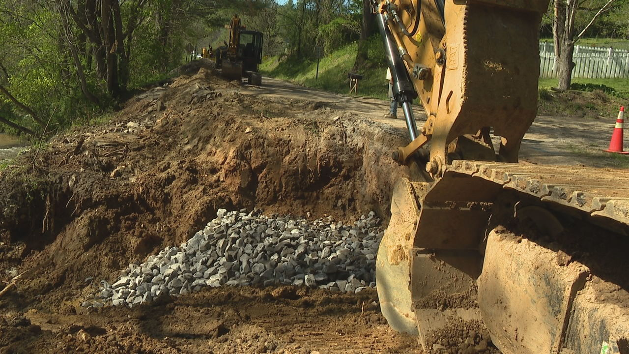 Heavy rains and flooding from this past weekend caused a nearby creek to overflow and erode the dirt supporting Gap Creek Road. (Photo credit: WLOS staff)