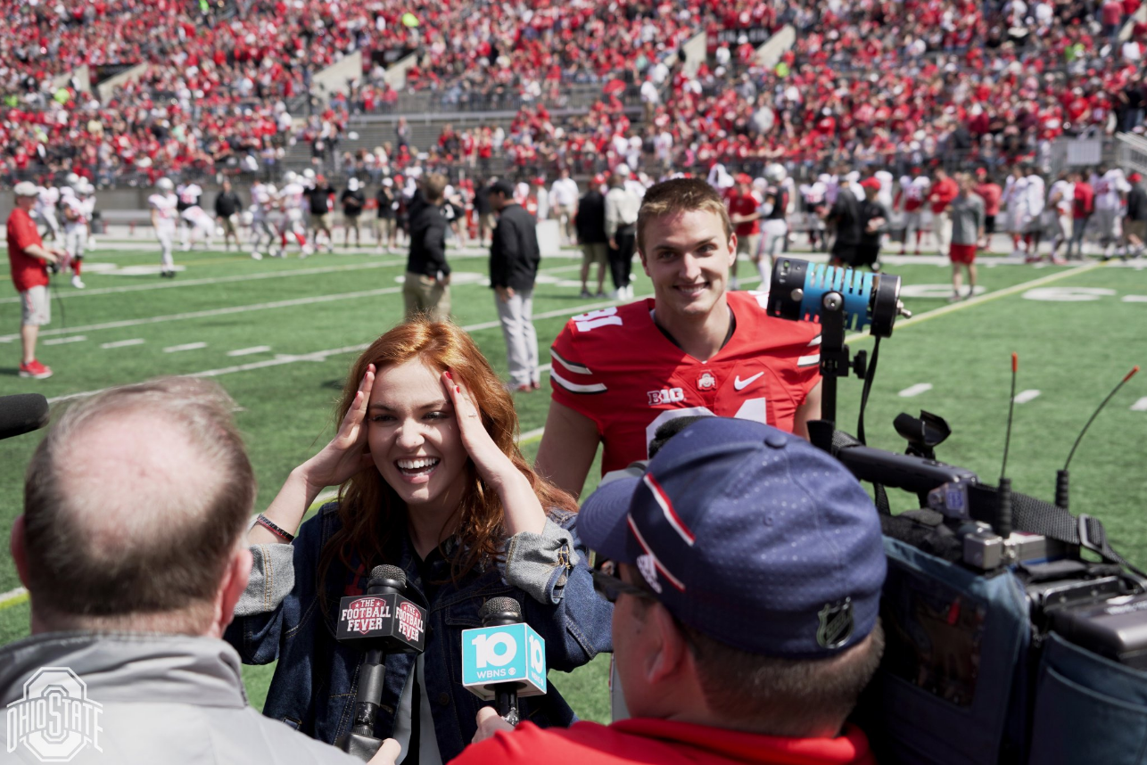 Ohio State punter Drue Chrisman and fiancé Avery Eliason speaking to The Football Fever's Clay Hall after Chrisman proposed during halftime of the Ohio State Spring Game on April 13, 2019. (Courtesy: Ohio State Athletics)