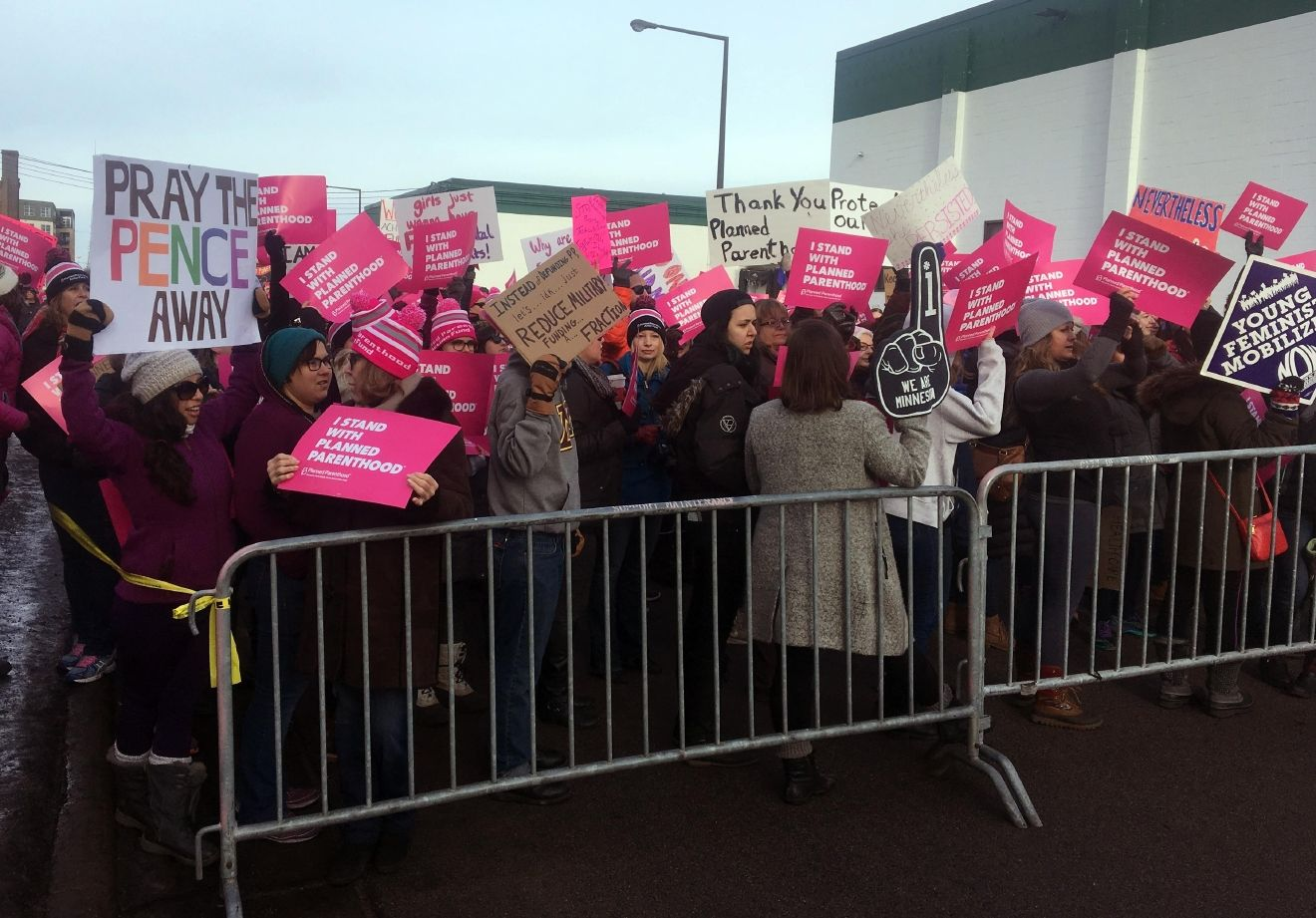 Supporters of Planned Parenthood hold counter protest as abortion opponents demonstrate outside Planned Parenthood  in St. Paul, Minn., on Saturday, Feb. 11, 2017.  Rallies aimed at urging Congress and President Donald Trump to end federal funding for Planned Parenthood are scheduled across the country.  (AP Photo/Jeff Baenen)