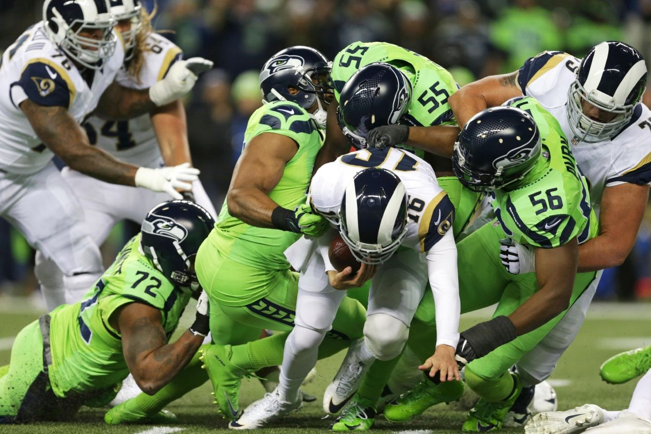 Los Angeles Rams quarterback Jared Goff (16) is sacked by Seattle Seahawks' Cliff Avril (56), Frank Clark (55), and Bobby Wagner, second from left, in the first half of an NFL football game, Thursday, Dec. 15, 2016, in Seattle. (AP Photo/Scott Eklund)