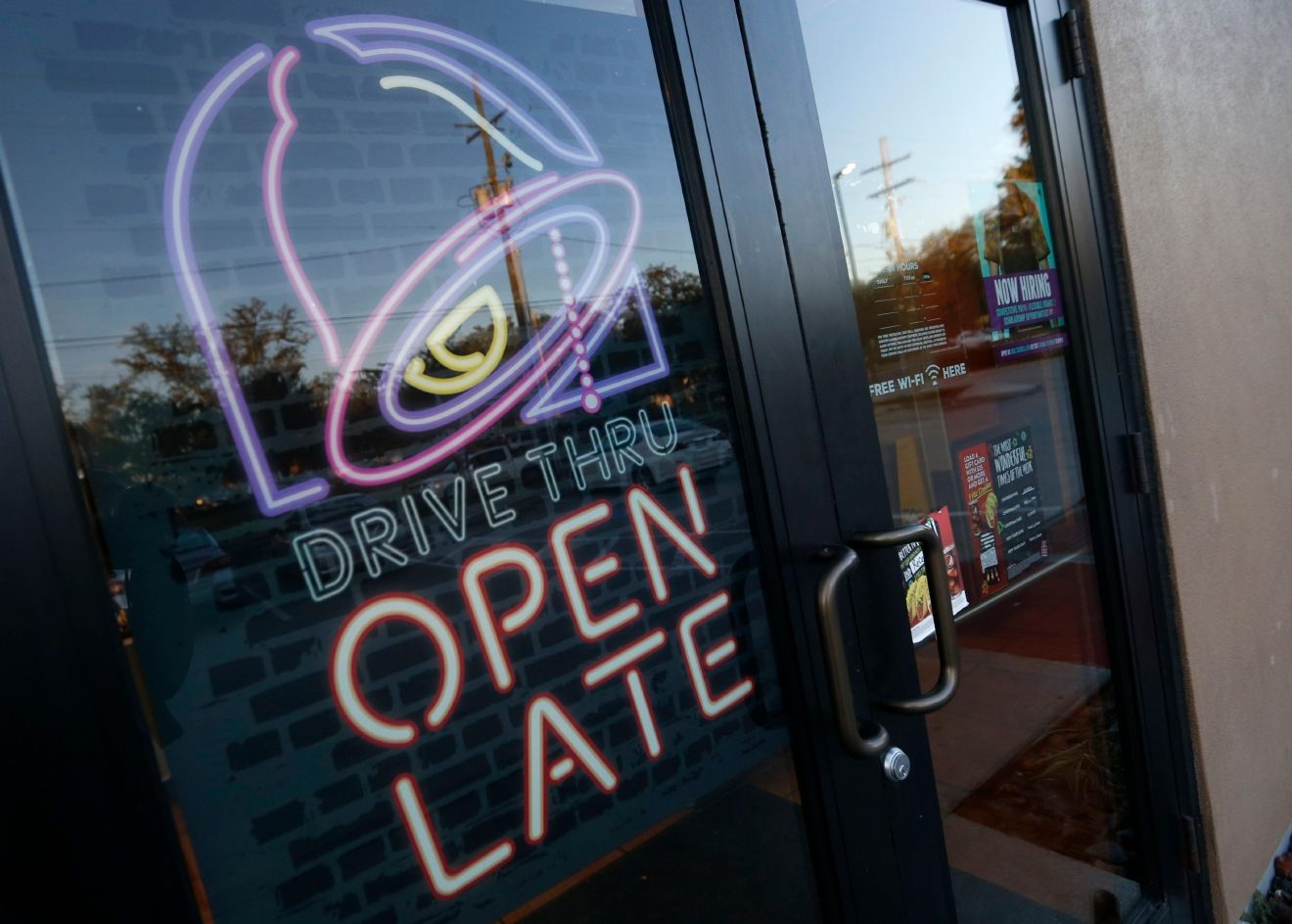 This Thursday, Dec. 15, 2016, photo shows a Taco Bell in Metairie, La. Yum Brands, Inc. reports financial earnings Thursday, Feb. 9, 2017. (AP Photo/Gerald Herbert)