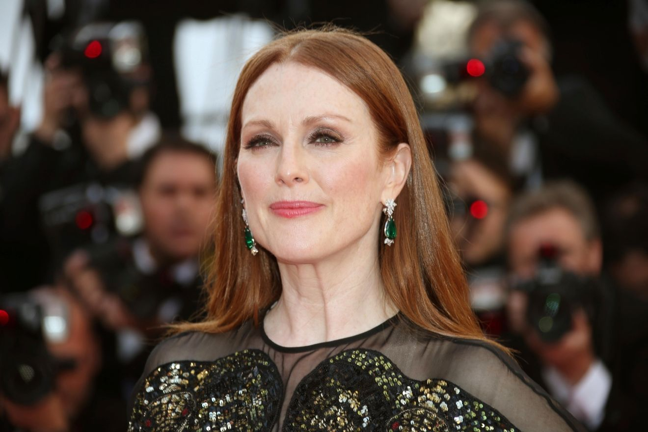 FILE - In this May 11, 2016 file photo, actress Julianne Moore arrives in Cannes, southern France. Hollywood will be turning out in force for the women's march on Washington set to follow Donald Trump's inauguration. (AP Photo/Joel Ryan, File)