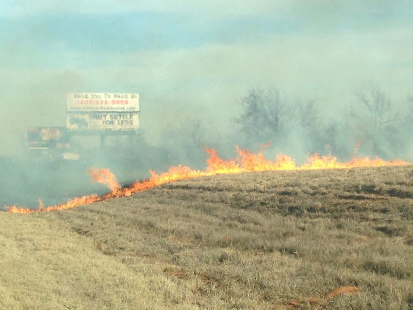 A grass fire burns in March of 2017 near the Grand Casino. (KOKH/Jennifer Falsetti)