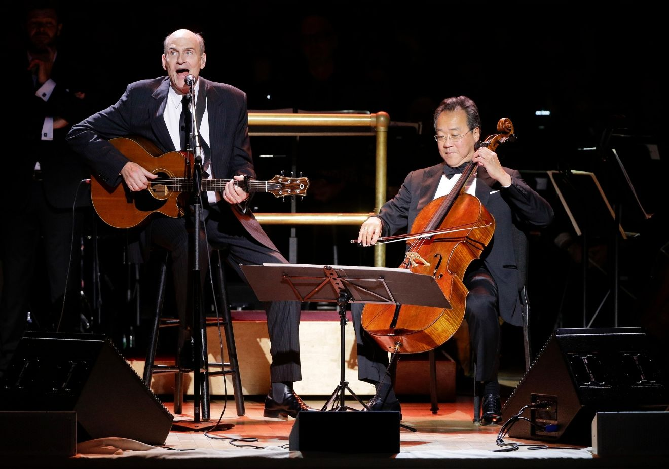 James Taylor, left, performs with cellist Yo-Yo Ma during Carnegie Hall's 125th Anniversary Concert, Thursday, May 5, 2016, in, New York. (AP Photo/Julie Jacobson)