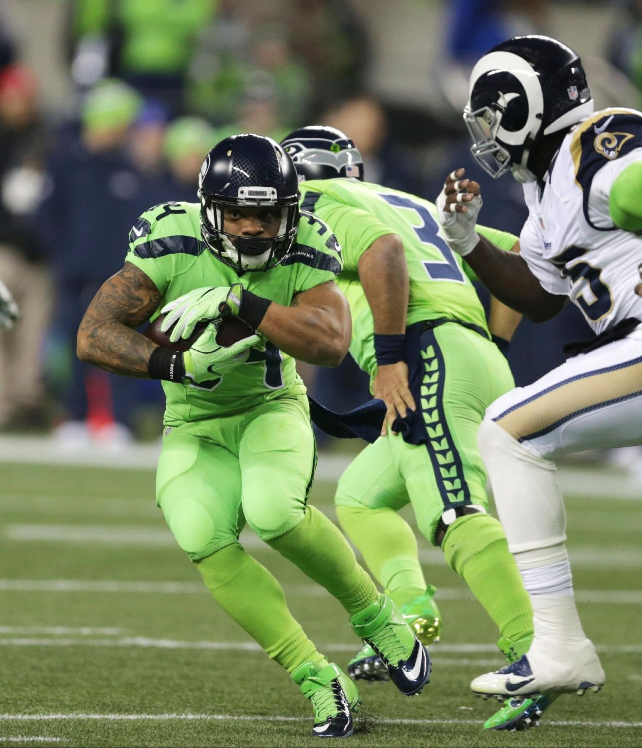 Seattle Seahawks running back Thomas Rawls rushes against the Los Angeles Rams in the first half of an NFL football game, Thursday, Dec. 15, 2016, in Seattle. (AP Photo/Scott Eklund)