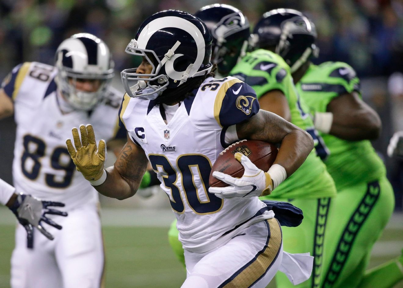 Los Angeles Rams running back Todd Gurley rushes against the Seattle Seahawks in the first half of an NFL football game, Thursday, Dec. 15, 2016, in Seattle. (AP Photo/Elaine Thompson)