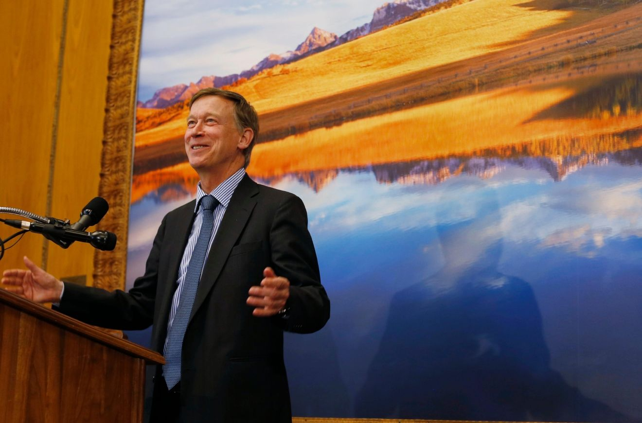 Colorado Gov. John Hickenlooper responds to questions during a news conference in the State Capitol after he signed a bill to gradually allow grocery stores to sell full-strength beer, liquor and wine on Friday, June 10, 2016, in Denver. (AP Photo/David Zalubowski)