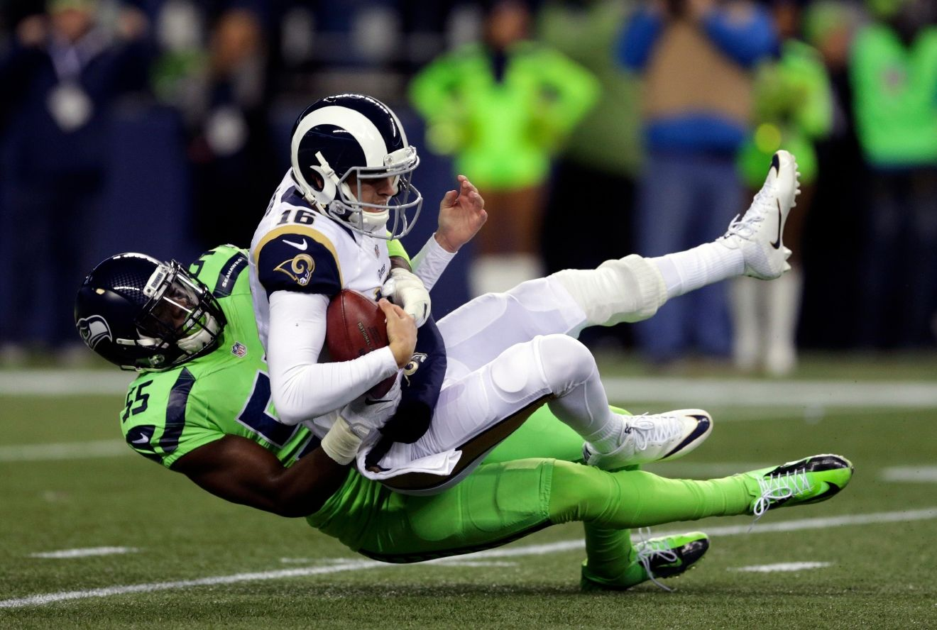 Los Angeles Rams quarterback Jared Goff, top, is sacked by Seattle Seahawks defensive end Frank Clark in the first half of an NFL football game, Thursday, Dec. 15, 2016, in Seattle.. (AP Photo/Scott Eklund)