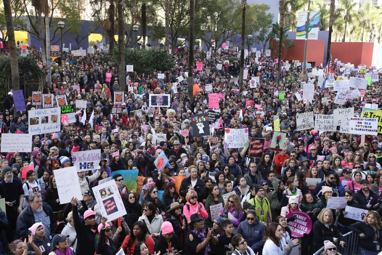 Protesters listen to a speaker as they fill the streets of downtown Los Angeles during the Women's March against President Donald Trump Saturday, Jan. 21, 2017.  he march was held in in conjunction with with similar events taking place in Washington and around the nation following the inauguration of President Donald Trump. (AP Photo/Jae C. Hong)