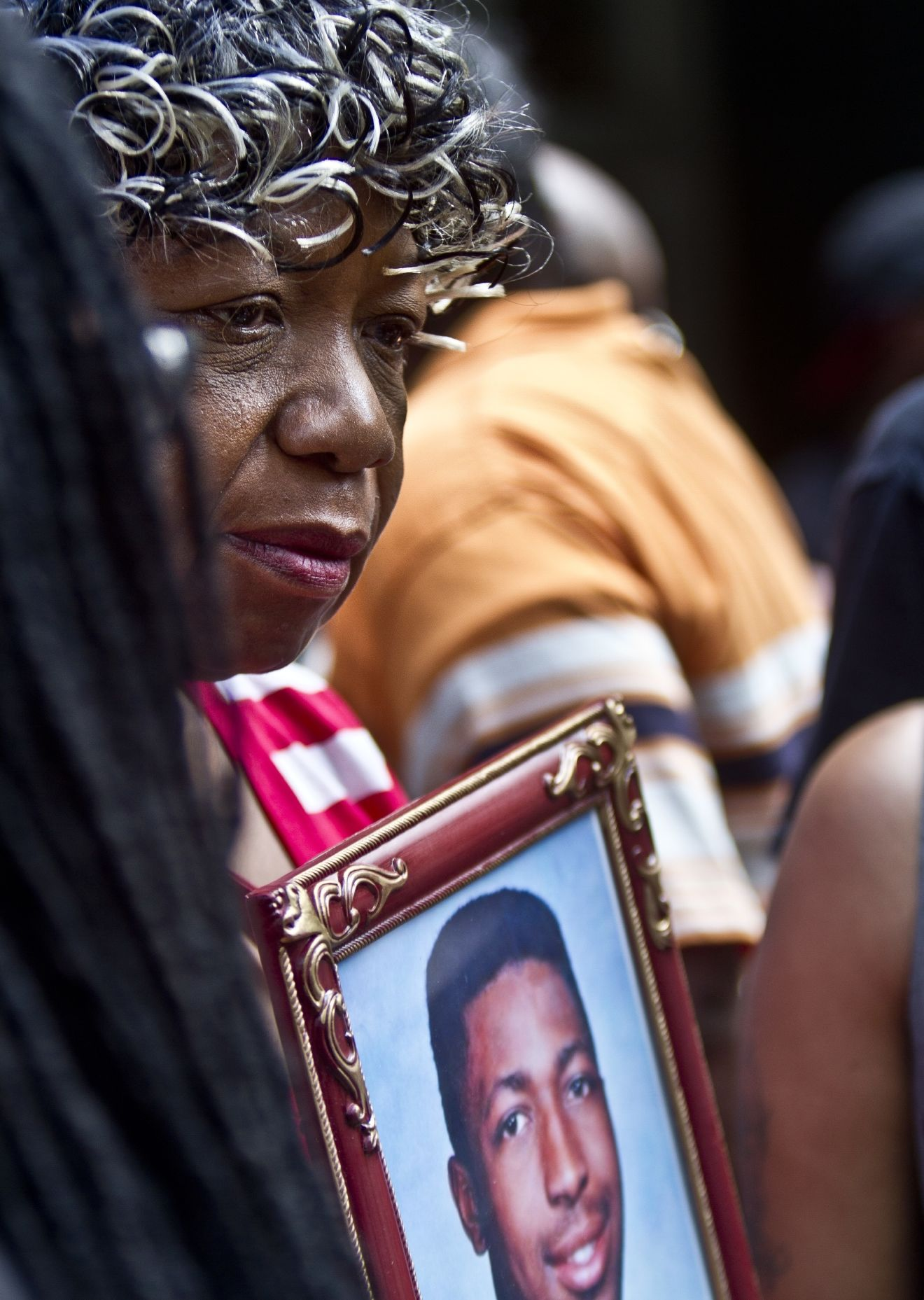 FILE - In this July 7, 2015 file photo, Gwen Carr holds a picture of her son, Eric Garner, during a news conference outside New York Gov. (AP Photo/Bebeto Matthews, File)