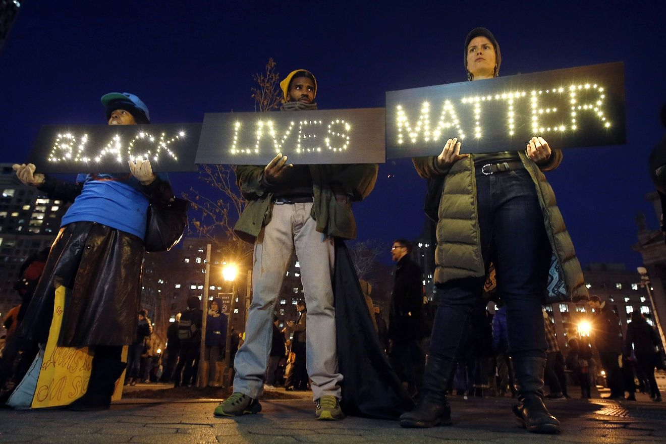 FILE - In this Dec. 4, 2014, file photo protesters rally in New York's Foley Square against a state grand jury's decision not to indict the police officer involved in the death of Eric Garner. (AP Photo/Jason DeCrow, File)