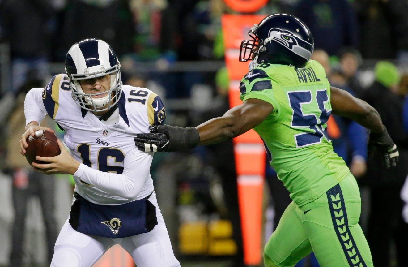 Seattle Seahawks defensive end Cliff Avril Cliff Avril, right, pressures Los Angeles Rams quarterback Jared Goff in the first half of an NFL football game, Thursday, Dec. 15, 2016, in Seattle. (AP Photo/Elaine Thompson)