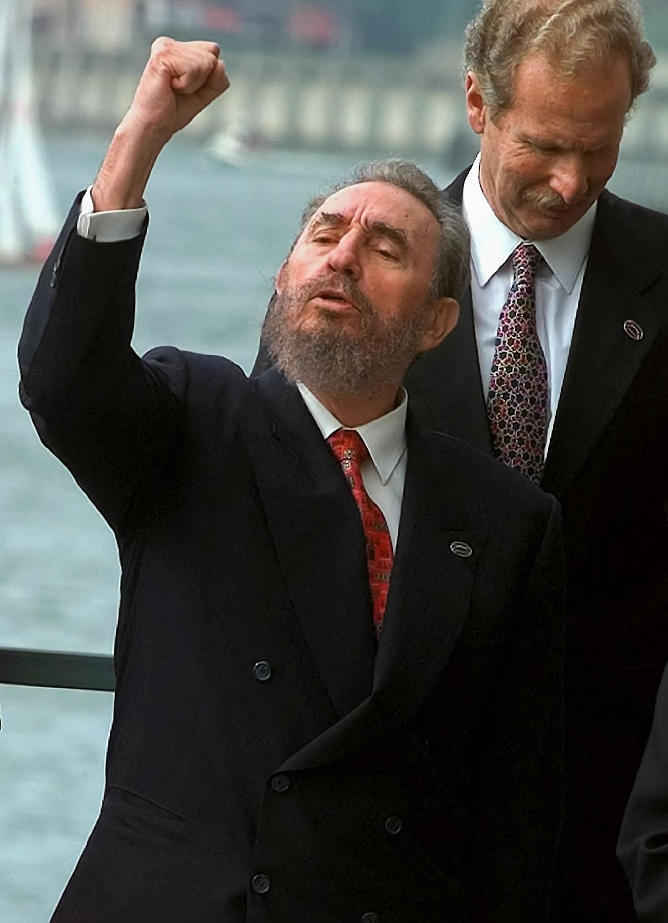 In this Sunday, October 18, 1998 file photo, Cuban leader Fidel Castro, left, shouts a slogan as he raises his fist during the VIII Ibero-American summit group picture in Oporto. (AP Photo/Domenico Stinellis)