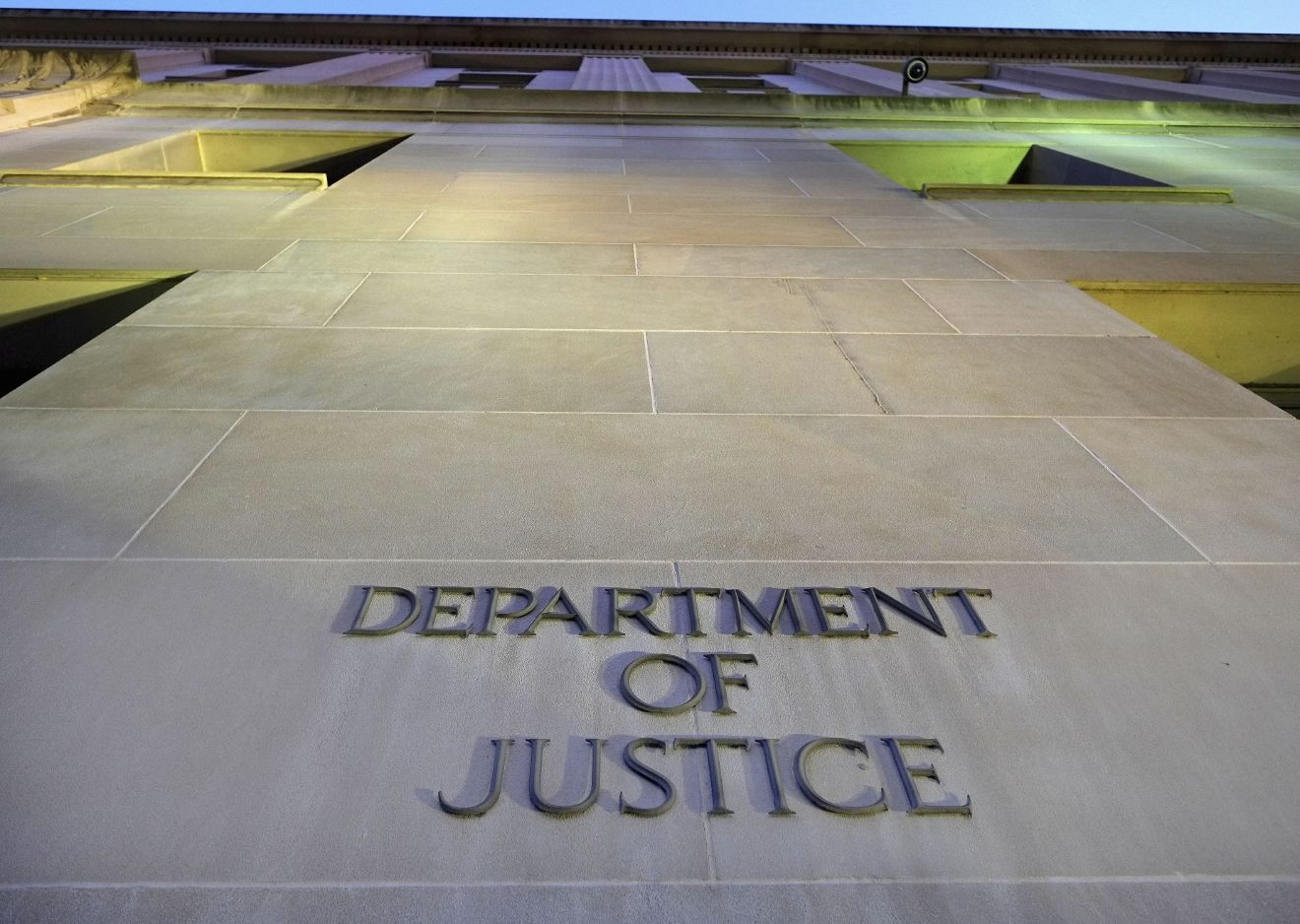 FILE - In this May 14, 2013, file photo, the Department of Justice headquarters building in Washington is photographed early in the morning.{ } (AP Photo/J. David Ake, File)