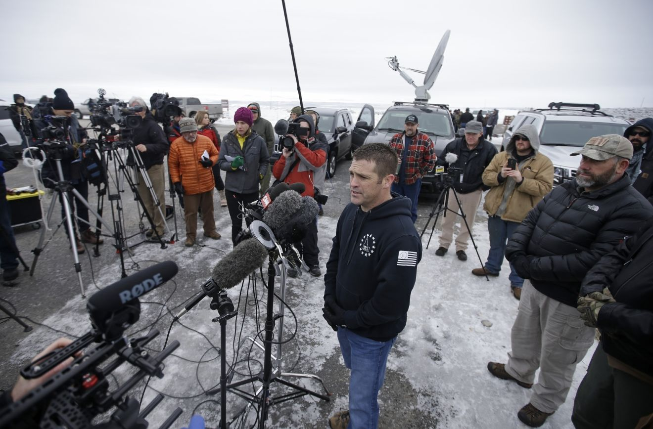 "FILE - In this Jan. 9, 2016, Brandon Curtiss of the ""Idaho 3%"" group speaks to the media after arriving at the Malheur National Wildlife Refuge near Burns, Ore. More than 30 members of the ""Idaho 3%"" group say they've resigned after Curtiss, the group's president, spent $2,900 in donations on personal items rather than using it to help four Idaho men facing charges from a 2014 armed standoff with government agents in Nevada. The 36 members in mainly leadership positions of Idaho 3% announced the resignations Tuesday, Sept. 28, 2016. (AP Photo/Rick Bowmer, File)"