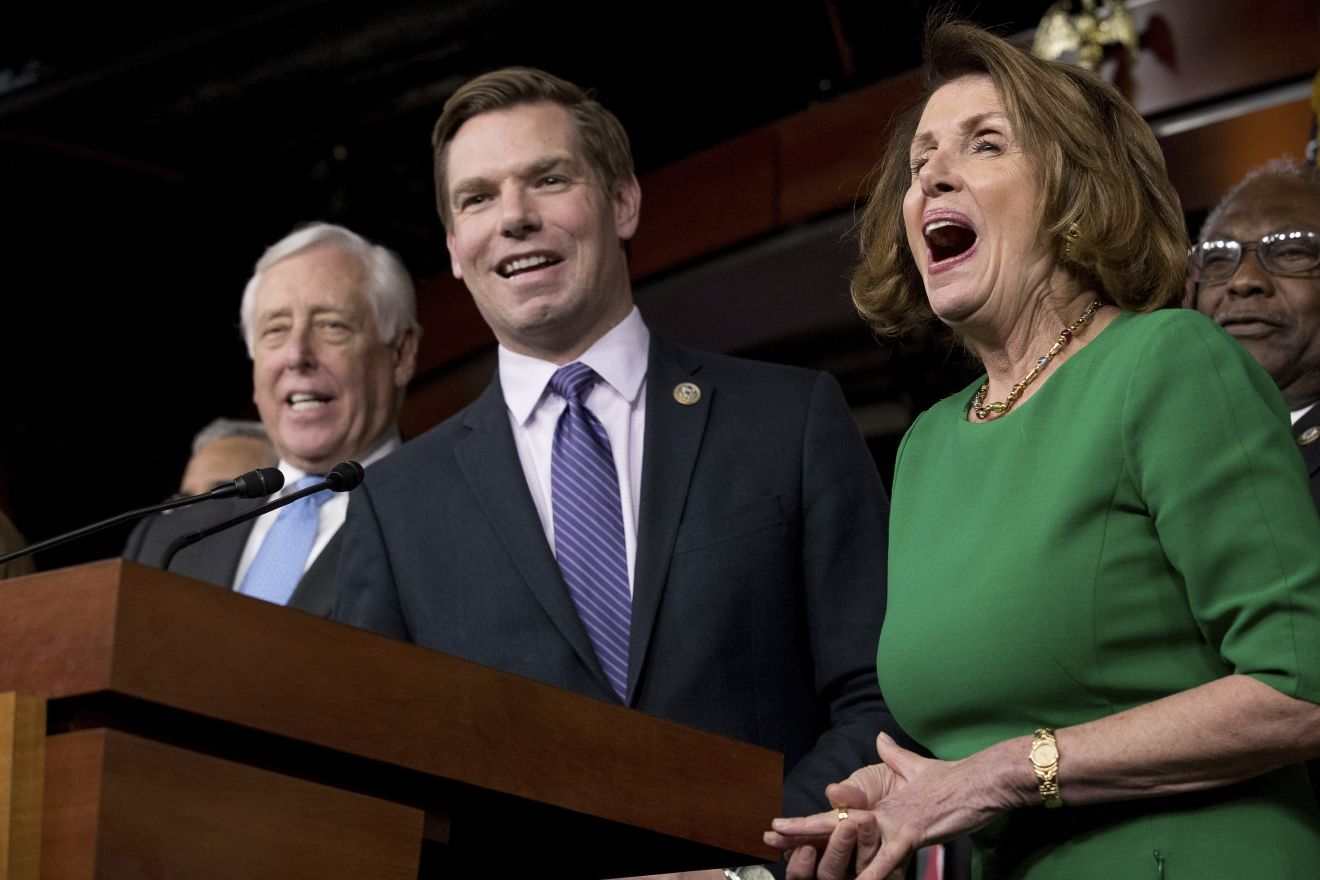 House Minority Leader Nancy Pelosi of Calif., right, and Democratic Whip Steny Hoyer, D-Md., react at a joke from Rep. Eric Swalwell, D-Calif., center, as he jokes while speaking at a news conference on Capitol Hill in Washington, Friday, March 24, 2017.(AP Photo/Andrew Harnik)