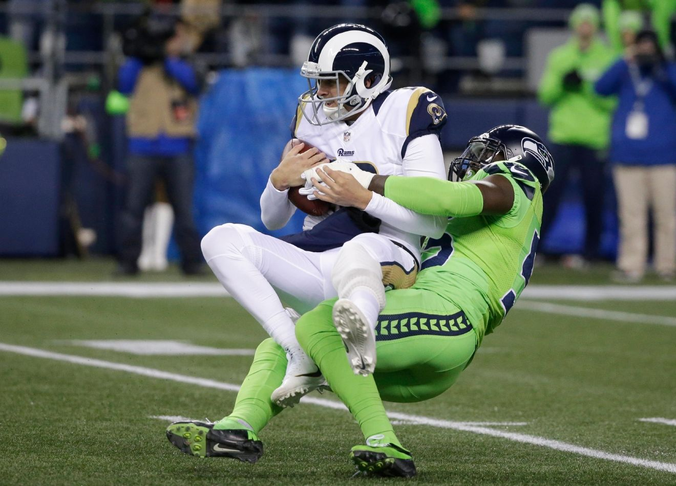 Los Angeles Rams quarterback Jared Goff is sacked by Seattle Seahawks defensive end Frank Clark in the first half of an NFL football game, Thursday, Dec. 15, 2016, in Seattle. (AP Photo/Elaine Thompson)