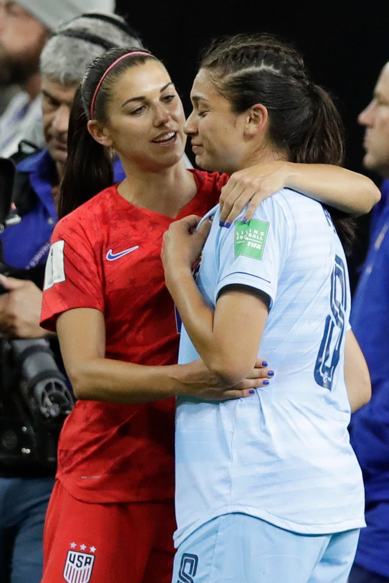 United States'Alex Morgan hugs Thailand's Miranda Nild at the end of the Women's World Cup Group F soccer match between United States and Thailand at the Stade Auguste-Delaune in Reims, France, Tuesday, June 11, 2019. United States beat Thailand 13-0. (AP Photo/Alessandra Tarantino)