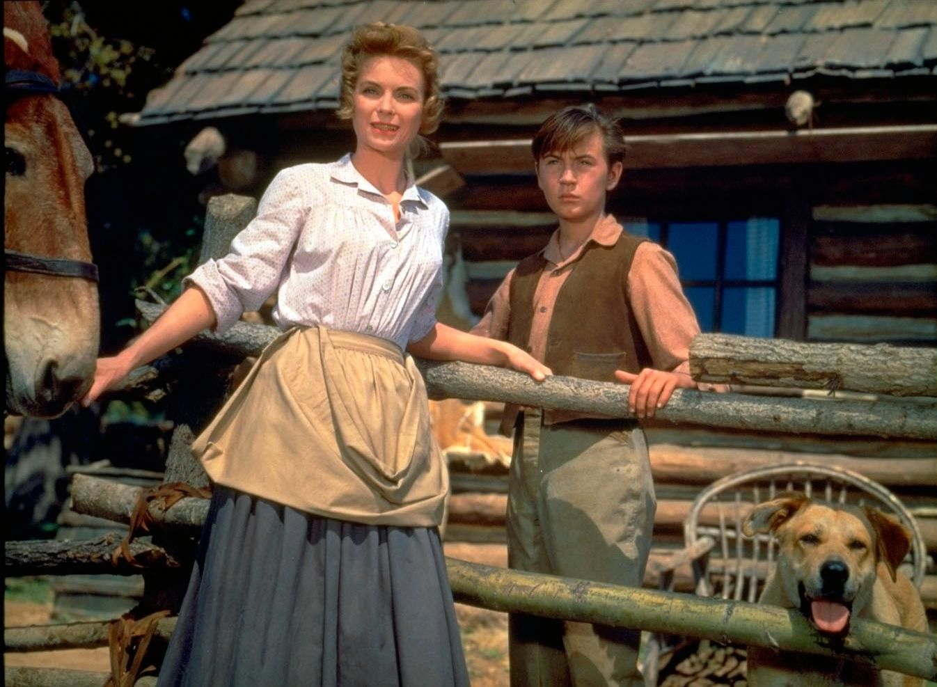 "This image released by Disney shows Dorothy McGuire, left, and Tommy Kirk in a scene from the 1957 classic ""Old Yeller."" The film is among 25 films to be added to the National Film Registry of the Library of Congress. (Disney via AP)"