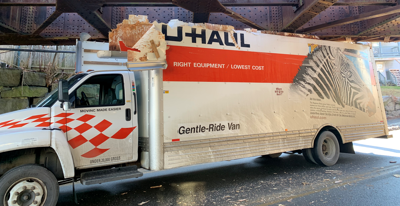 A U-Haul truck is the bridge's latest victim. (Guy Verra)