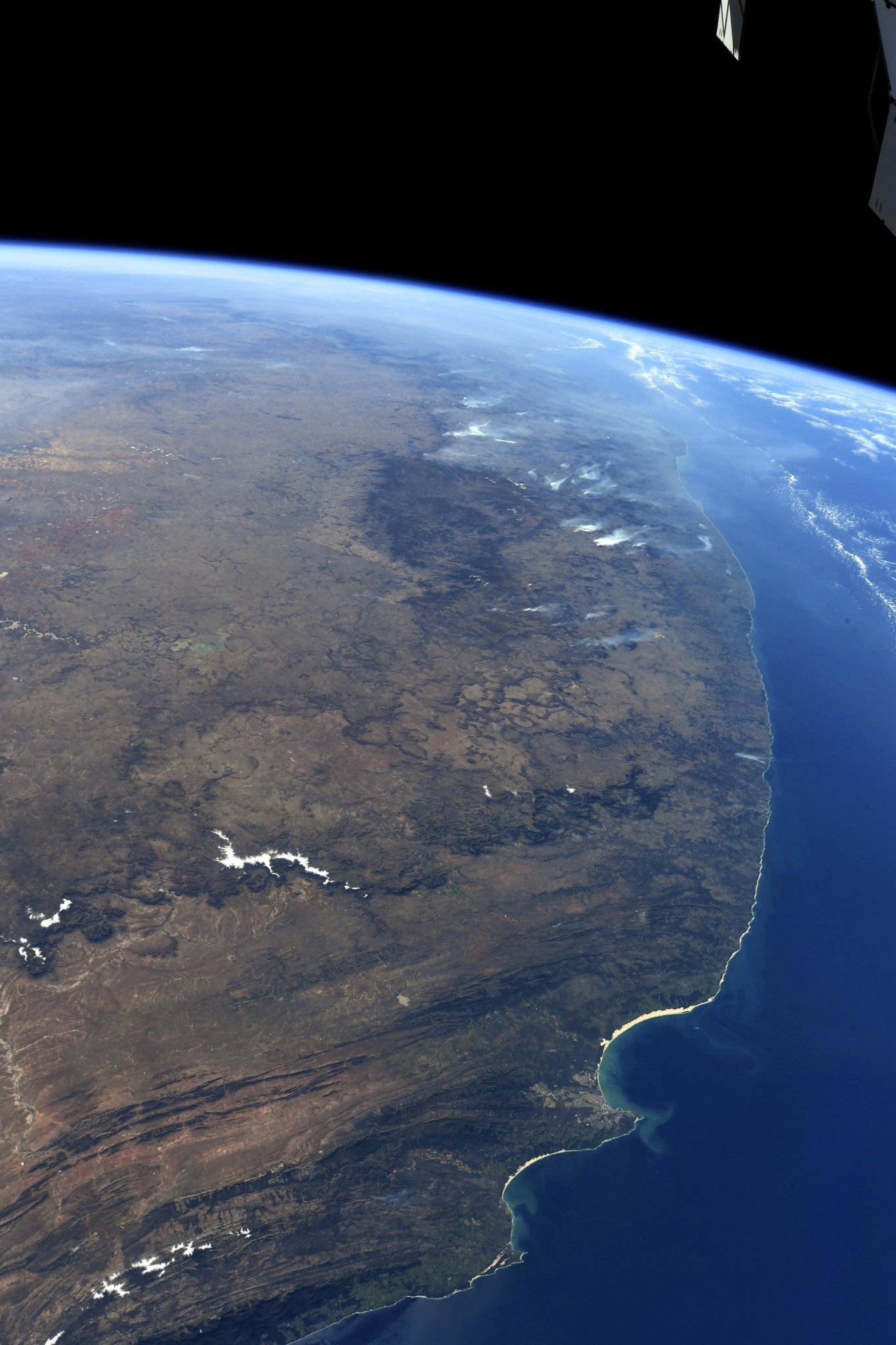 Smoke from ubiquitous brush fires obscures the horizon looking northwards from Port Elizabeth, #SouthAfrica (Photo & Caption Ricky Arnold, NASA)