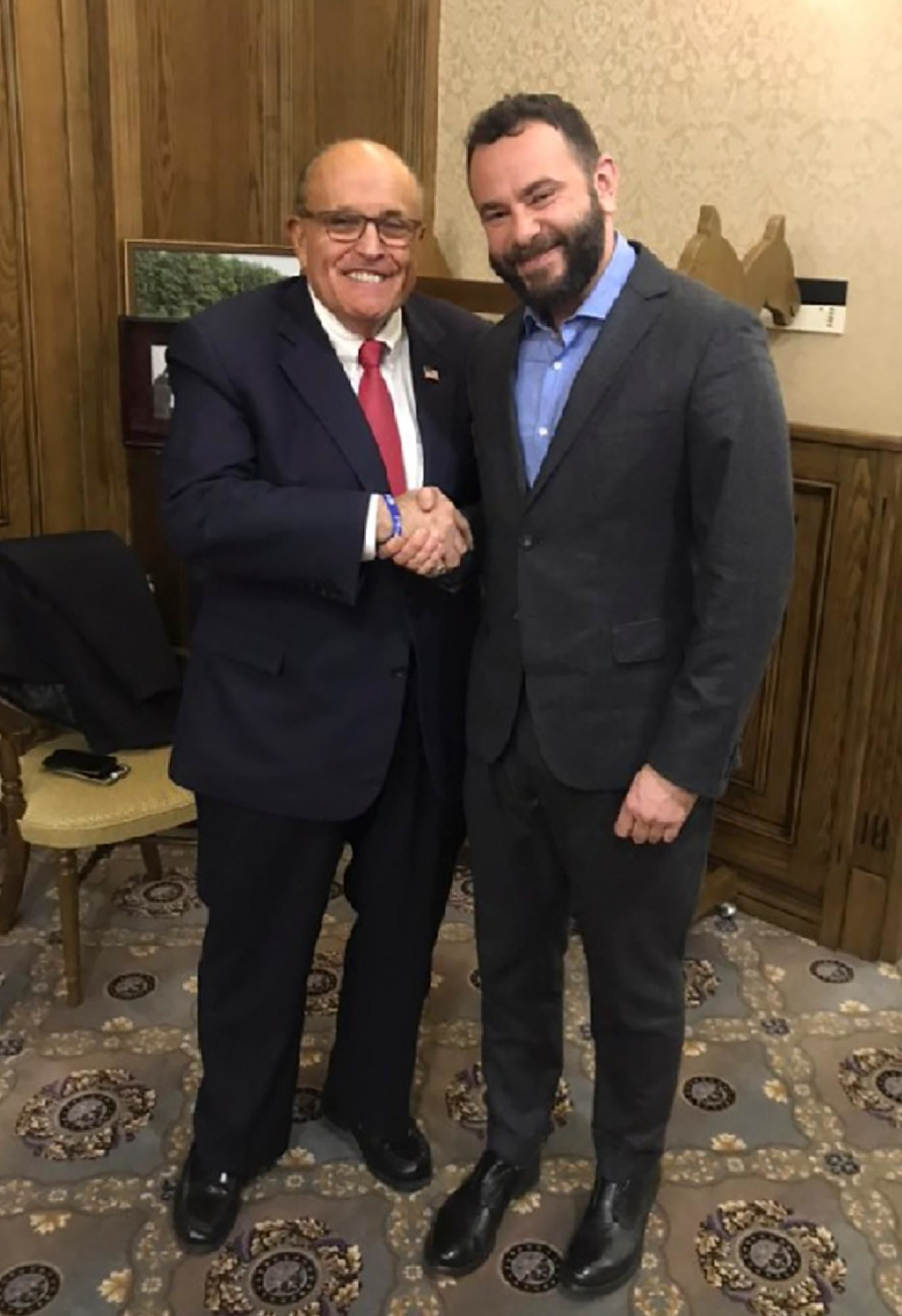 In this handout photo provided by Oleksandr Dubinsky's press office and taken on late Thursday, Dec. 5, 2019, Rudy Giuliani, an attorney for U.S President Donald Trump, left, meets with Ukrainian lawmaker Oleksandr Dubinsky in Kyiv, Ukraine. (Adriii Dubinsky's press office via AP)
