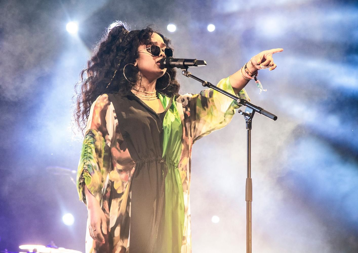 FILE - This April 14, 2019 file photo shows H.E.R. performing at the Coachella Music & Arts Festival in Indio, Calif. H.E.R., who scored five nominations at last year's Grammys, including a bid for best new artist, returns this year with five more nominations. (Photo by Amy Harris/Invision/AP, File)