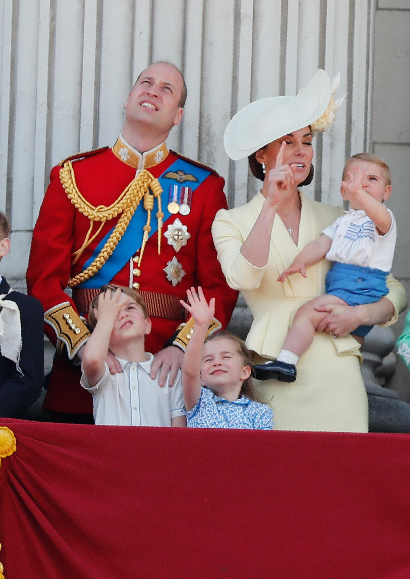 Britain's Prince William and Kate, the Duchess of Cambridge with their Prince George, center left, Princess Charlotte, center, and Prince Louis, top center, attend the annual Trooping the Colour Ceremony in London, Saturday, June 8, 2019. Trooping the Colour is the Queen's Birthday Parade and one of the nation's most impressive and iconic annual events attended by almost every member of the Royal Family. (AP Photo/Frank Augstein)